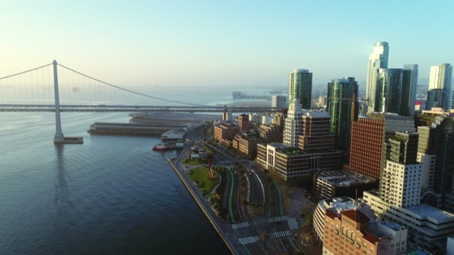 Aerial view of San Francisco city skyline and Embarcadero at sunrise video