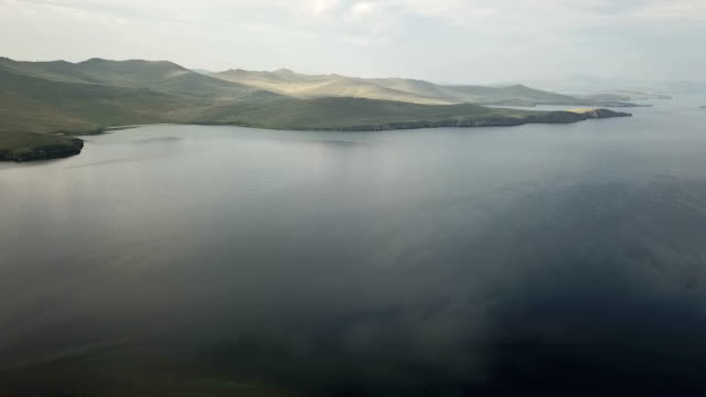 Aerial view of sand beach and crystal clean water of Baikal Lake. Aerial view of sand beach and crystal clean water of Baikal Lake. siberia stock videos & royalty-free footage