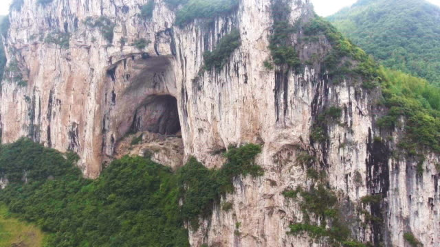 Aerial view of Scenic Cliff of Mountain and Crave, Guizhou Province, China Aerial view of Scenic Cliff of Mountain and Crave, Guizhou Province, China cave stock videos & royalty-free footage