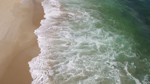 4k aerial view of sea, waves and sand - gulf coast states stock videos & royalty-free footage