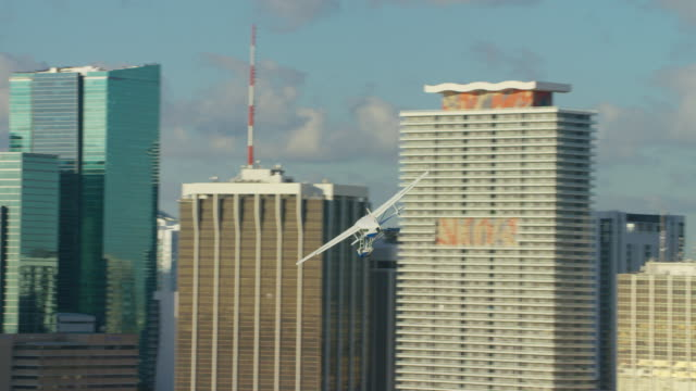 Aerial view of seaplane flying by downtown Miami Aerial view of seaplane flying by downtown Miami, Florida propeller airplane stock videos & royalty-free footage