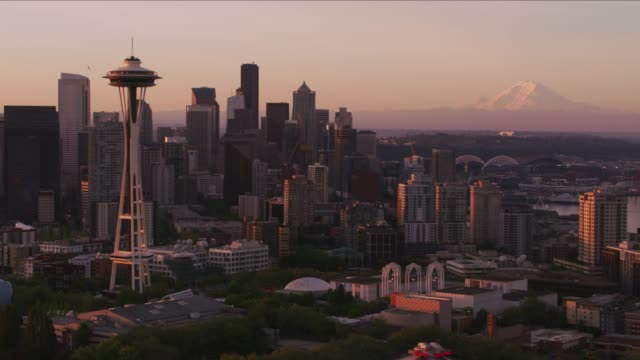 Aerial view of Seattle at sunrise with Space Needle and Mt. Rainier.