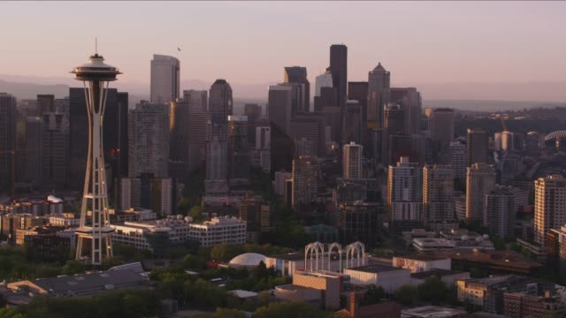 Aerial view of Seattle at sunrise with Space Needle and Mt. Rainier. Seattle, Washington circa-2017, Aerial view of Seattle at sunrise with Space Needle and Mt. Rainier.  Shot with Cineflex and RED Epic-W Helium. seattle stock videos & royalty-free footage