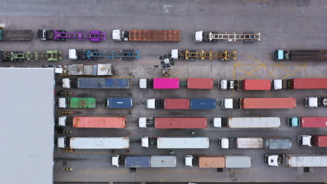 Aerial view of semi truck and trailer loading at logistic center, Business freight shipping import export transportation by semi truck trailer vehicle. Aerial view of semi truck and trailer loading at logistic center, Business freight shipping import export transportation by semi truck trailer vehicle. warehouse aerial stock videos & royalty-free footage