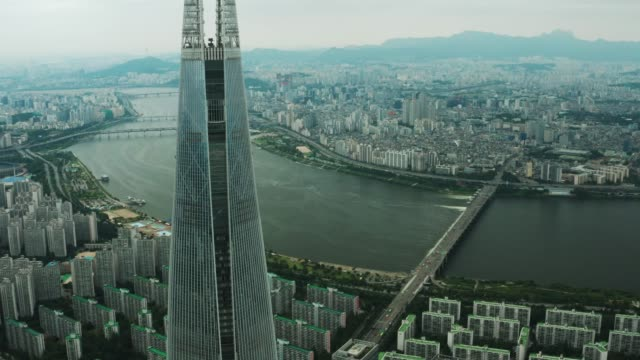 Aerial view of Seoul city centre Aerial view of Seoul city centre, Seoul in a cloudy weather, city around the Hangang river seoul stock videos & royalty-free footage