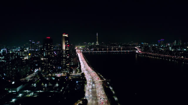 Aerial view of Seoul downtown city skyline with light trails on expressway and bridge cross over Han river at night in Seoul city, South Korea. Aerial view of Seoul downtown city skyline with light trails on expressway and bridge cross over Han river at night in Seoul city, South Korea. namsan seoul stock videos & royalty-free footage