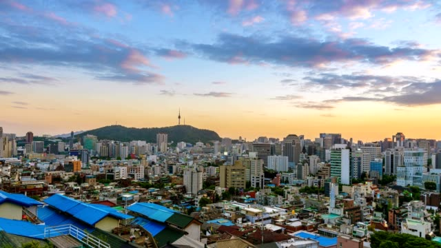 Aerial view of Seoul downtown cityscape and Ewha wall painting village from day to night. Seoul, South Korea. video