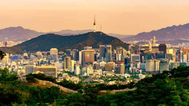 Aerial view of Seoul downtown cityscape and Namsan Seoul Tower from day to night. Seoul, South Korea. video