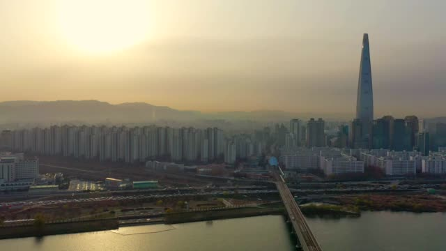 Aerial view of seoul, south korea with Lotte World Tower Building and Jamsil Station Bridge Aerial view of Seoul with Lotte World Tower Building The tallest building in South Korea namsan seoul stock videos & royalty-free footage