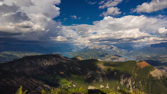 aerial view of serre-poncon lake in summer with clouds. hautes-alpes timelapse, alps, france - barrage de serre poncon stock videos & royalty-free footage