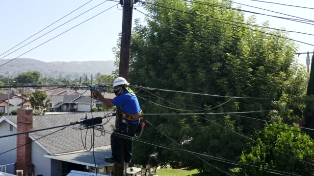 Aerial View of Service Technician Working on Lines