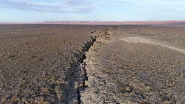 aerial view of sesriem canyon in the namib desert - дикая местность стоковые видео и кадры b-roll