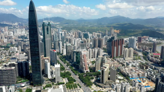 aerial view of shenzhen cityscape at daytime - шэньчжэнь стоковые видео и кадры b-roll