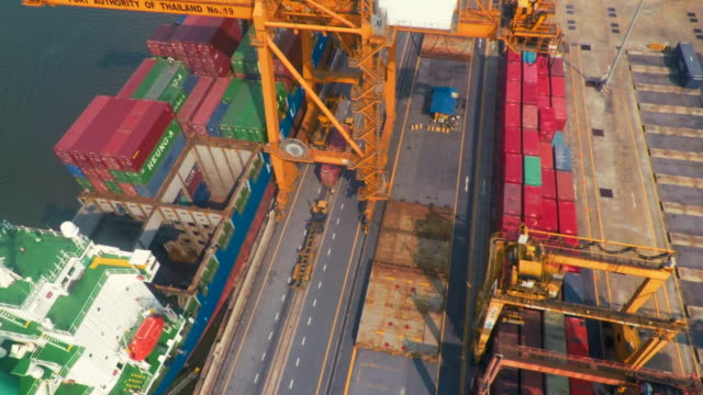 Aerial view of shippng containers being unload  from a cargo ship video