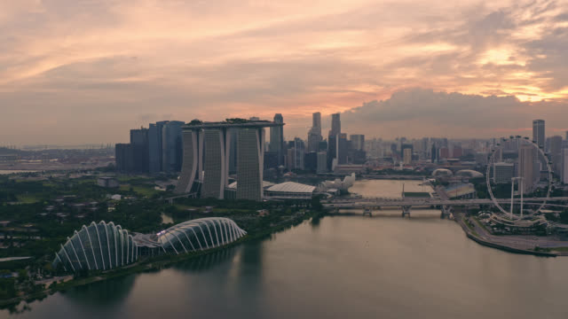 Aerial view of Singapore business district downtown at sunset Aerial view of Singapore business district downtown at sunset singapore architecture stock videos & royalty-free footage