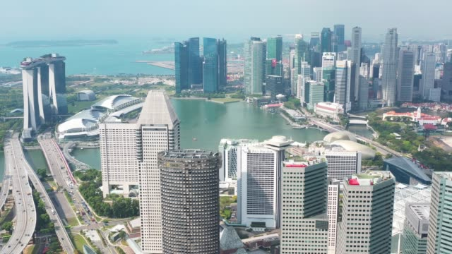 Aerial view of Singapore  with financial district buildings,hotels,tourist attractions.Travel destination in Asia Aerial view of Singapore with financial district buildings,hotels,tourist attractions.Travel destination in Asia singapore architecture stock videos & royalty-free footage
