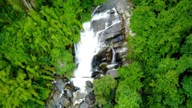 Aerial view of Sirithan waterfall with spray of water Splashing one of the famous waterfall at Doi Inthanon National Park mountain. Located in Chiang Mai, Thailand. video