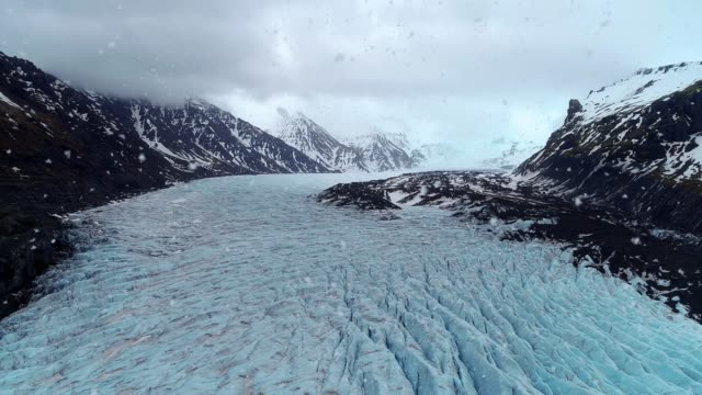 Aerial view of Skaftafell glacier with snowfall in winter, Vatnajokull National Park in Iceland. video