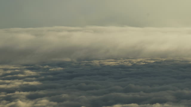 aerial view of sky clouds from an airplane window - d'atmosfera video stock e b–roll