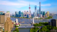 istock Aerial view of skyscraper and high-rise office buildings in Shanghai Downtown with Huangpu River, China. Financial district and business centers in smart city in Asia at noon with blue sky. 1149330925
