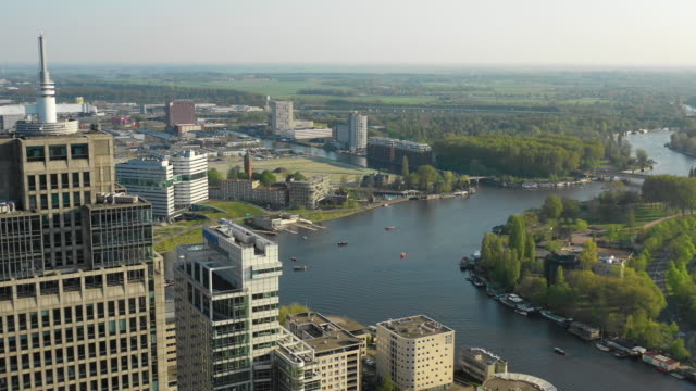 aerial view of skyscrapers and amstel river - dutch architecture stock videos & royalty-free footage