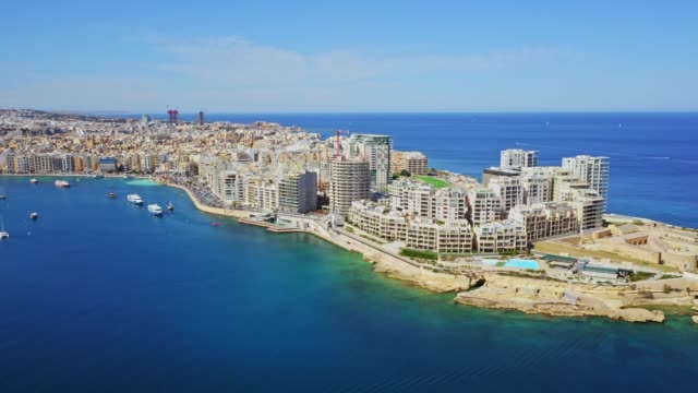 Aerial view of Sliema city. Buildings, apartments, blue sky, Mediterranean sea. Malta island