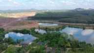 istock Aerial view of Small dam for rain flood protection in countryside, Thailand 1134803639