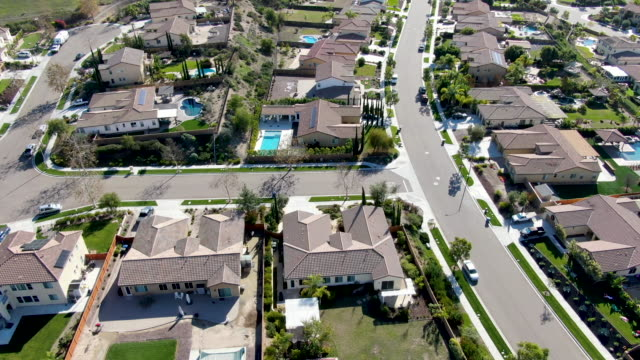 Aerial view of small neighborhood road with residential luxury houses in California
