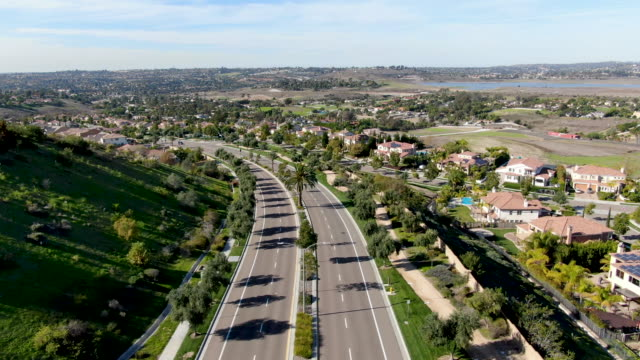 Aerial view of small neighborhood road with residential modern subdivision luxury houses