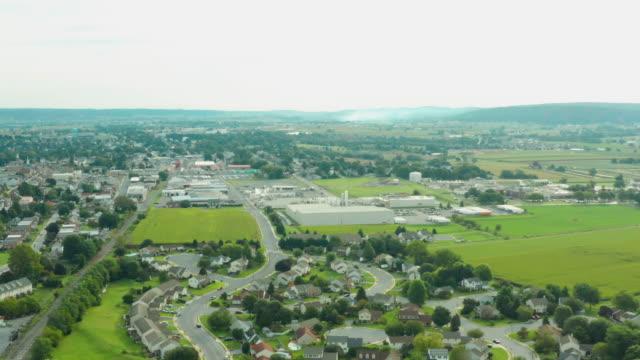 Aerial View of Small Town Near Rural Farmland