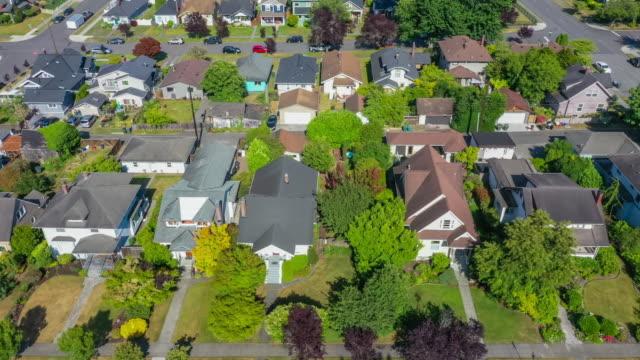 aerial view of small town suburban rooftops - жилой район стоковые видео и кадры b-roll