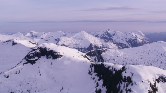 Aerial view of snow covered mountain range. video