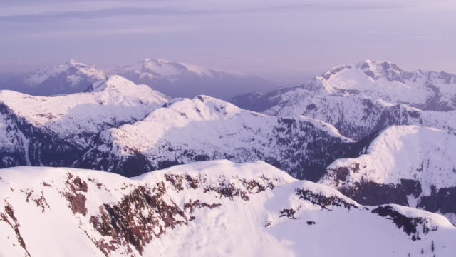 Aerial view of snow covered mountain range.