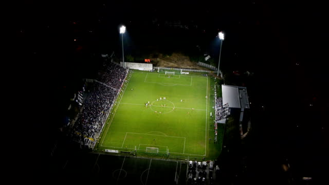 Aerial view of soccer game in night stadium video