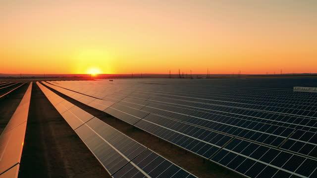 Aerial view of solar farm at dusk video