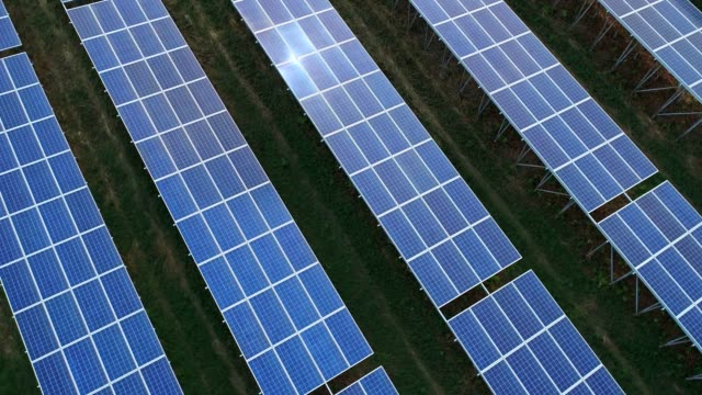4K Aerial view of Solar Panels Farm (solar cell) with sunlight