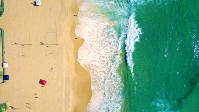 Aerial view of splashing sea waves and beach at Gold Coast video