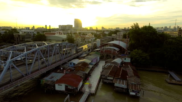 Aerial view of Steel Bridge and Traffic Jam in the Morning with Golden Sky
