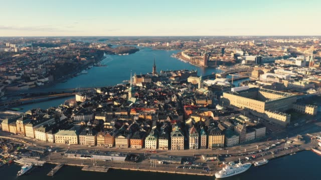 STOCKHOLM, SWEDEN - FEBRUARY, 2020: Aerial view of Stockholm city centre Gamla stan. Flying over buildings in old town. STOCKHOLM, SWEDEN - FEBRUARY, 2020: Aerial drone view of Stockholm old city centre Gamla stan. Flying over city buildings in the old town. stockholm stock videos & royalty-free footage