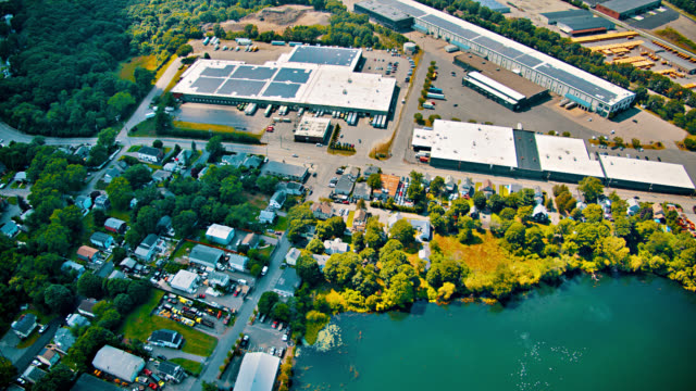 Aerial view of Store, warehouse. Solar panel. Tree. Country.