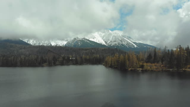 Aerial view of Strbske Pleso in the Clouds and Snowy Mountains. Slovakia