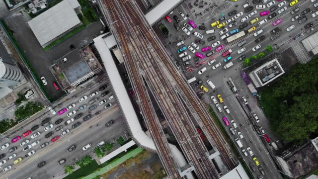 Aerial View of Street Intersection and bridge link between mrt and bts mass transportation in Bangkok,Thailand video