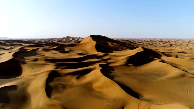 aerial view of strong shadows created by desert landscape, u.a.e. - paesi del golfo video stock e b–roll