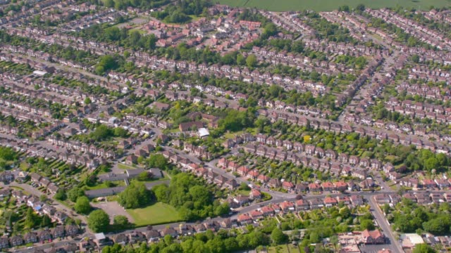 aerial view of suburban houses in london, uk. 4k - città diffusa video stock e b–roll