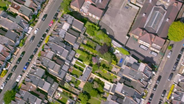 aerial view of suburban victorian houses in london, uk. 4k - inghilterra sud orientale video stock e b–roll