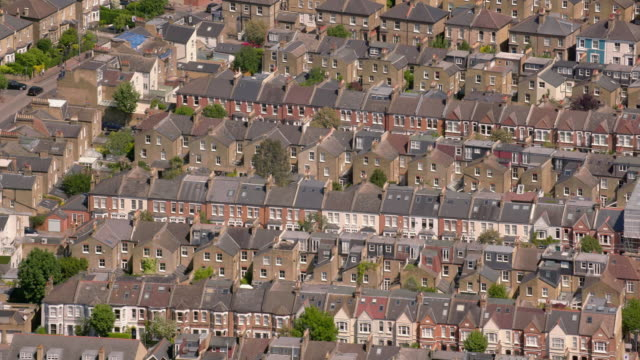 Aerial View of Suburban Victorian Houses in London, UK. 4K An aerial shot of a pretty suburban residential area in west London, UK, featuring Victorian terraced or row houses. Filmed from a helicopter in full 4K in lovely sunshine. 19th century style stock videos & royalty-free footage
