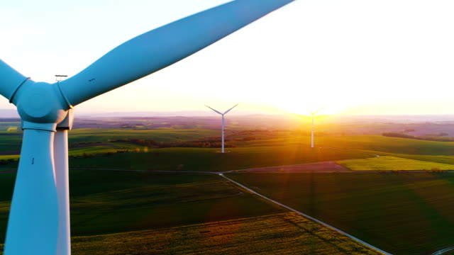 Aerial view of summer countryside with wind turbines and agricultural fields 4K Windmill and Wind power technology background. Aerial view on Wind Power, Turbine, Windmill, Energy Production - Green technology. Renewable energy solution windmill stock videos & royalty-free footage