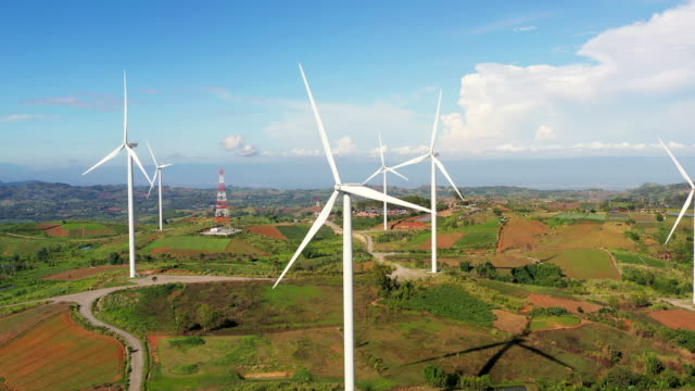 Aerial view of summer countryside with wind turbines
