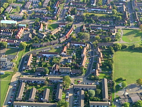 Aerial view of sunny suburbia (two shots). NTSC, PAL video