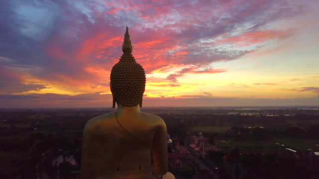 aerial view of sunrise at big buddha wat muang landmark of ang thong province, thailand - tempio video stock e b–roll